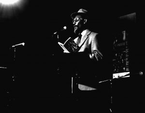 Linton Kwesi Johnson on stage, 17 March 2007 By ismocritico666 (CC BY 2.0) via Wikimedia Commons