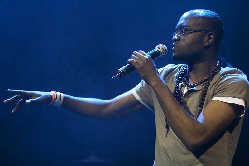 Inua Ellams performing on stage